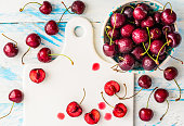 Cherry fruits on white wood rustic table.