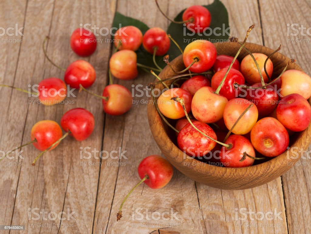 Fresh cherries scattered on a wooden table. royalty-free stock photo