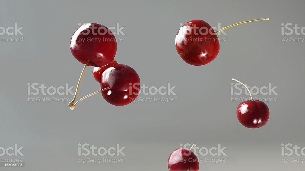 fresh cherry falling down 2 royalty-free stock photo