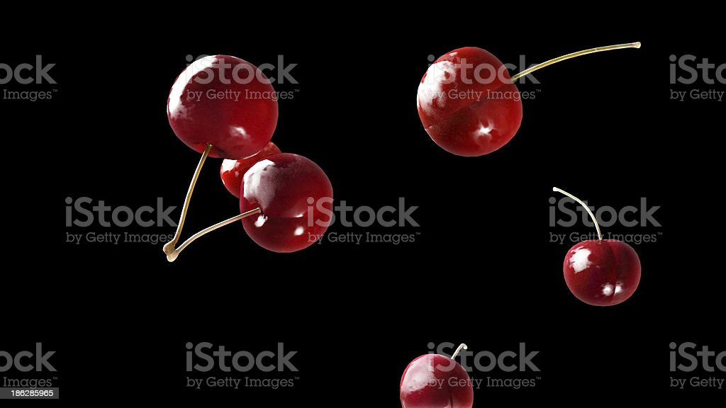 fresh cherry falling down black 3 royalty-free stock photo