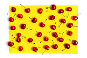 Fresh cherry fruit on yellow background flat lay
