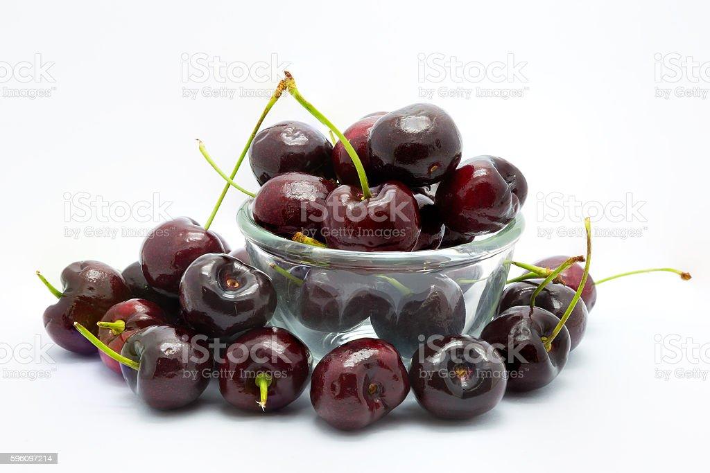 Fresh cherry on a cup of glass on white Lizenzfreies stock-foto