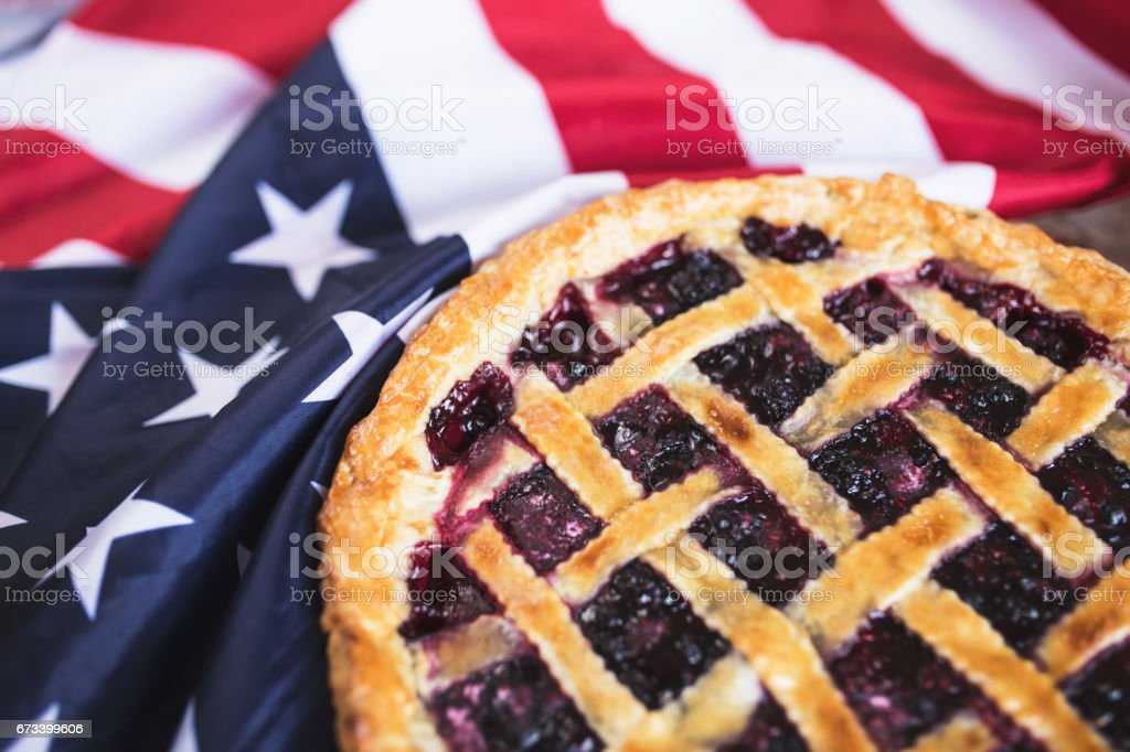 Fresh Cherry pie on an American flag. stock photo
