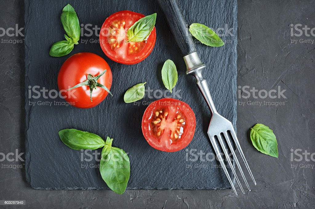 Fresh cherry tomatoes and basil stock photo