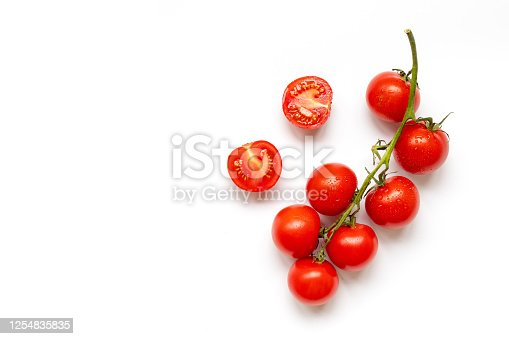 Fresh cherry tomatoes on branch isolated on a white background, flat lay