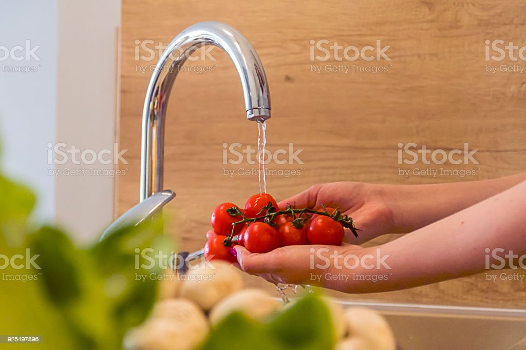 Fresh cherry tomatoes washed clean water stock photo