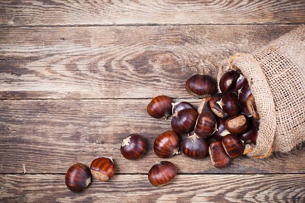Fresh chestnuts in sack bag stock photo