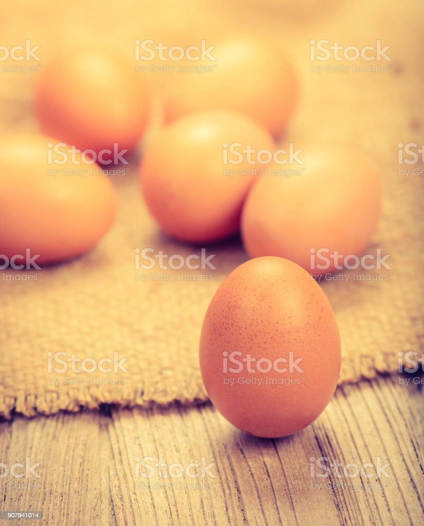 fresh chicken eggs on wood table,vintage process style stock photo