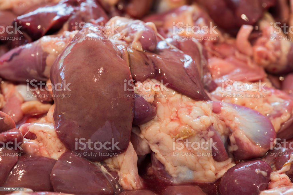 Fresh chicken entrails on display in a meat market stock photo