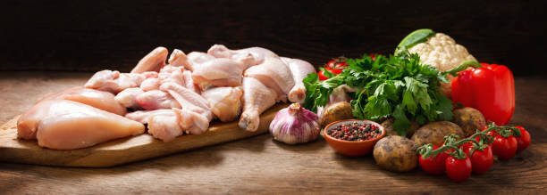 fresh chicken meat and ingredients for cooking stock photo