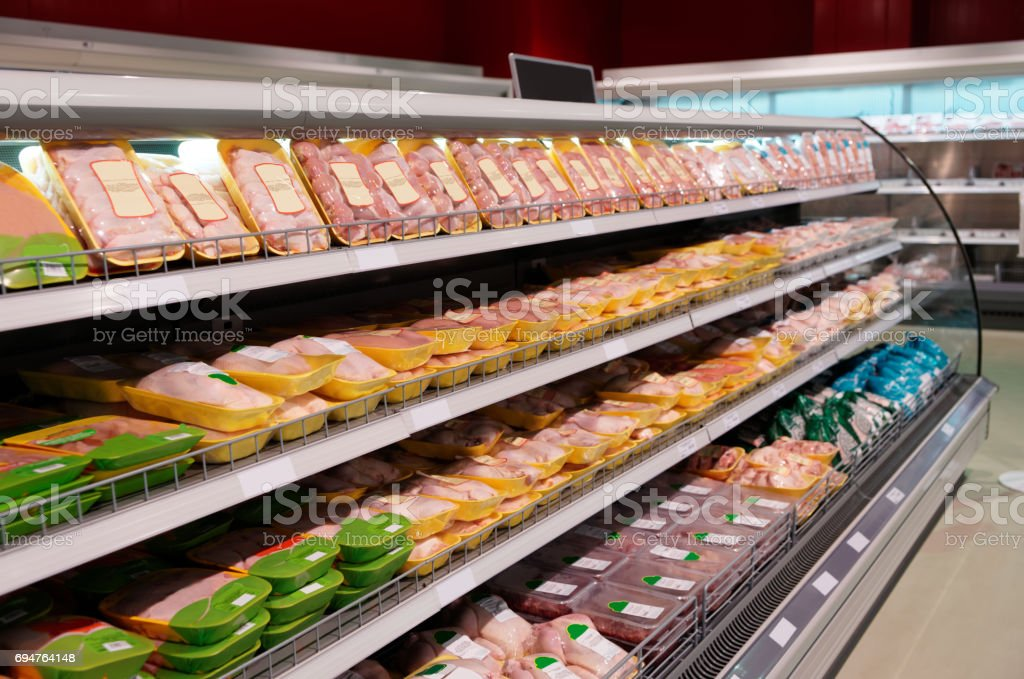 Fresh chicken meat on supermarket shelf stock photo