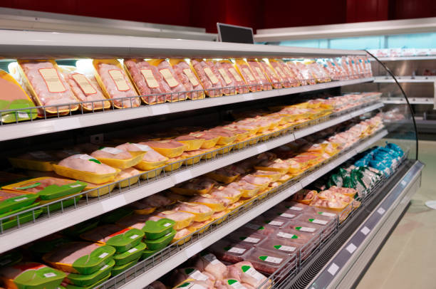 Fresh chicken meat on supermarket shelf stock photo
