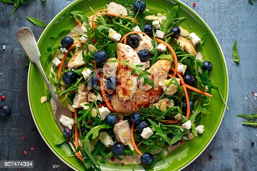 istock Fresh Chicken salad with Blueberries, feta, carrots, nuts and green vegetables. healthy food concept 927474334