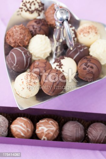 183269671 istock photo Fresh chocolate truffles on metal tray and in a box 175414092