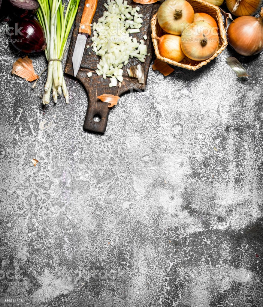 Fresh chopped onion on the old Board. On rustic background. stock photo