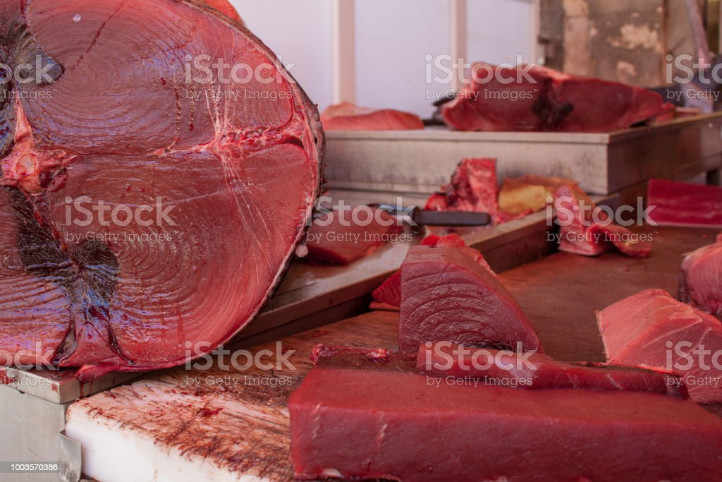Fresh chopped tuna fillet on the fish market counter. stock photo