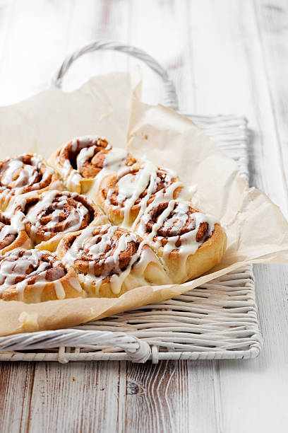 Fresh cinnamon roles on a wicker tray stock photo