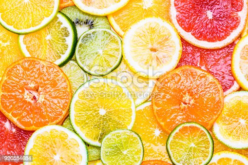 istock Fresh citrus fruits sliced assortment top view flat lay background. 920584684
