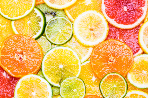 fresh citrus fruits sliced assortment top view flat lay background. - agrume foto e immagini stock