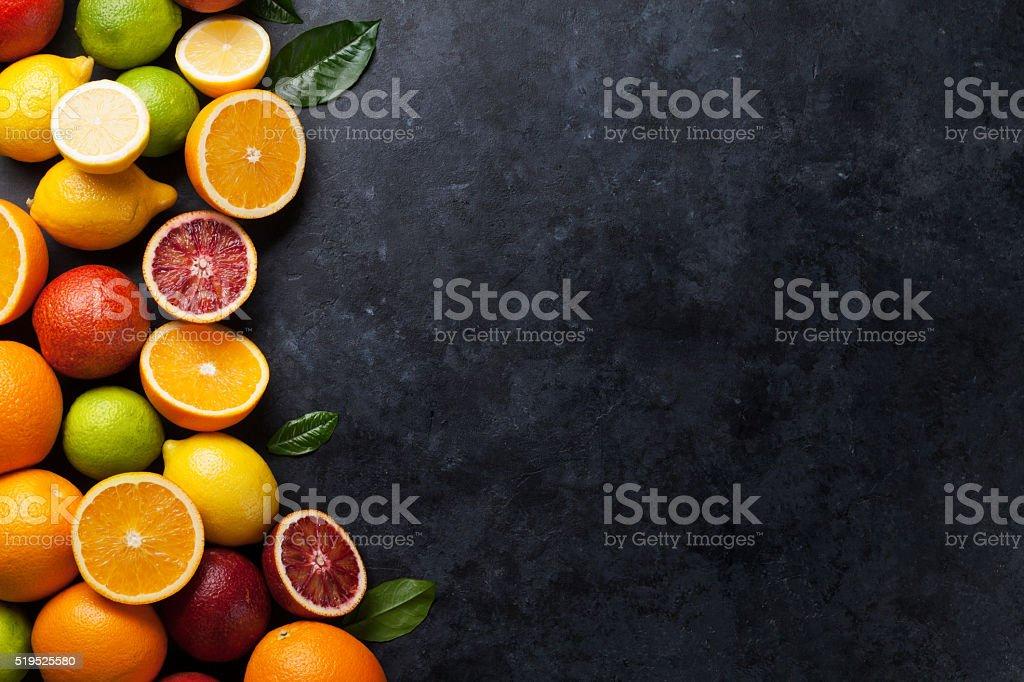 Fresh citruses on dark stone stock photo