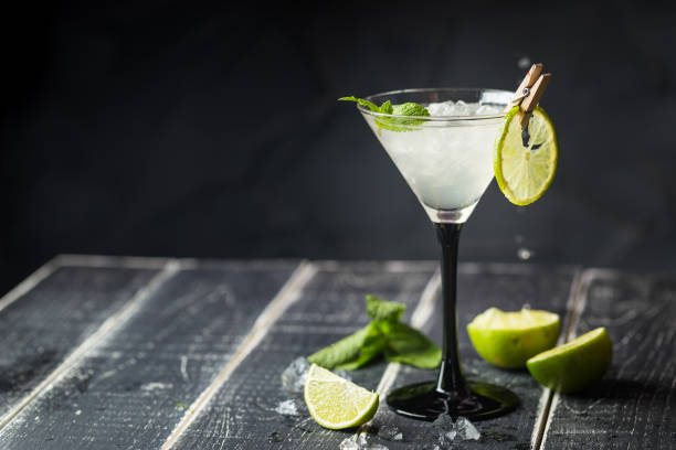 fresh classic lime margarita cocktail - margarita drink stock photos and pictures