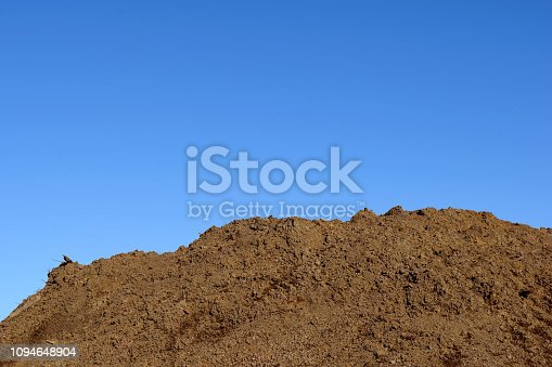 Fresh Clean Topsoil Dirt Hill for Organic Gardening and Landscaping Blue Sky Type Area