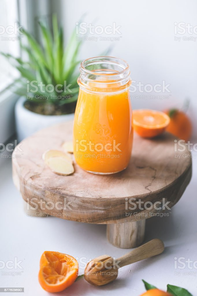 Fresh clementine juice stock photo