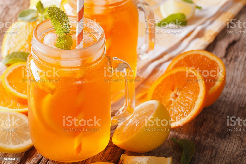 Fresh cocktail with oranges, lemons, ice and mint stock photo