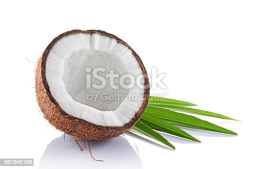 Healthy food. Fresh coconut with green palm leaves isolated on white background