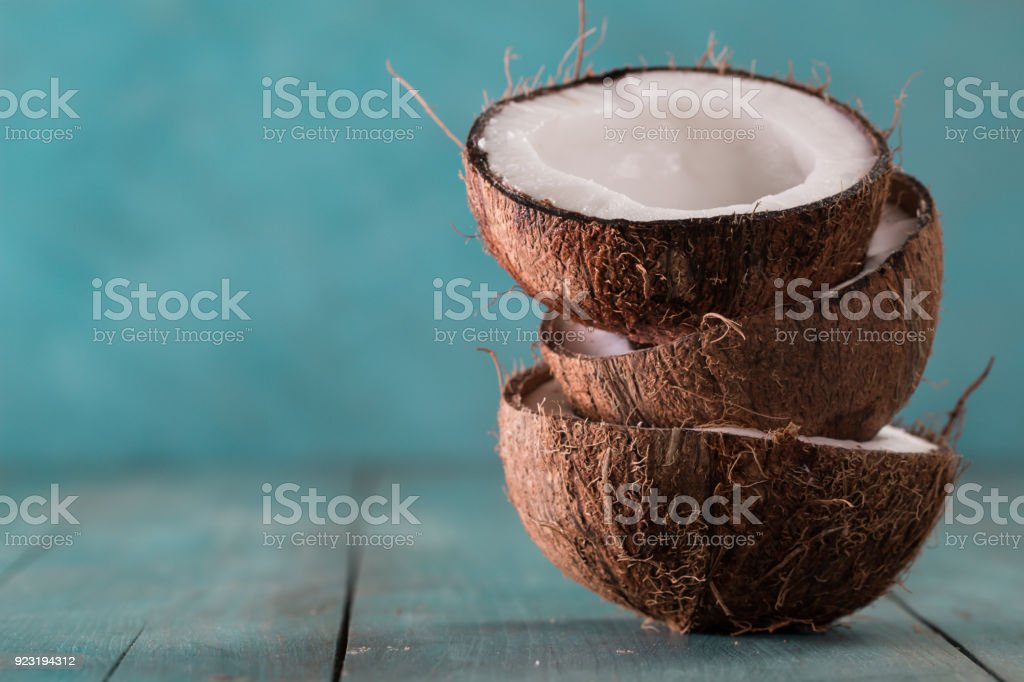 fresh coconuts on blue background,healthy food concept royalty-free stock photo