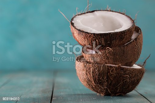 fresh coconuts on blue background,healthy food concept
