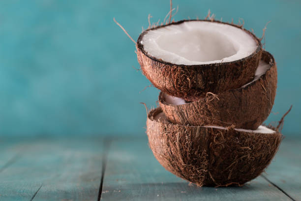 fresh coconuts on blue background,healthy food concept stock photo