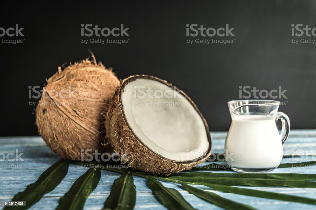 fresh coconuts on old wooden table. stock photo