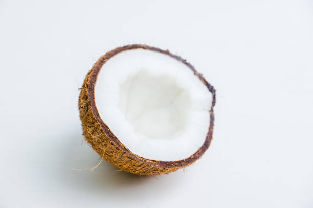 Fresh coconuts on the rustic background stock photo