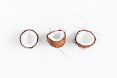 Fresh coconuts on white background. Flat lay, top view