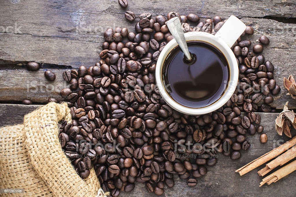 Fresh coffee beans on the old wooden floor stock photo