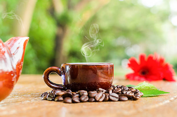 Fresh coffee in a mug & Kettle with stock photo