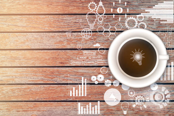 fresh coffee on the table with graph and business strategy sketches stock photo