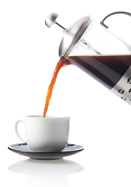 Fresh coffee poured on white.  coffee pot stock pictures, royalty-free photos & images