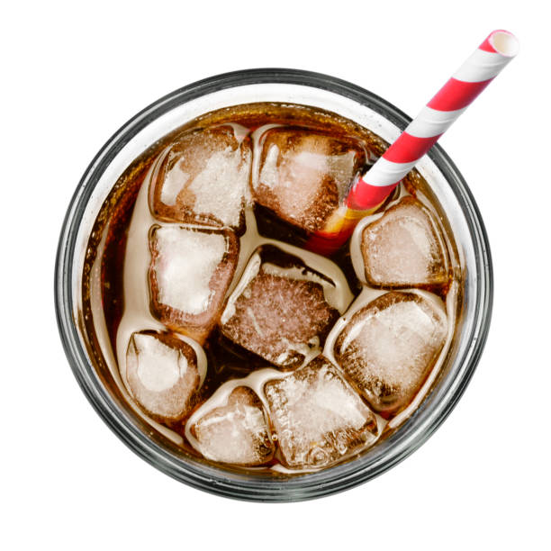 Fresh coke in glass, top view Fresh coke in glass, top view or high angle shot Coca Cola with ice and drinking straw, isolated on white background. drinking straw stock pictures, royalty-free photos & images
