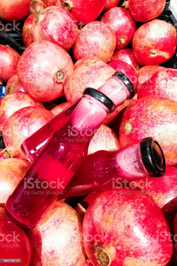 Fresh cold pressed organic pomegranate juice against pomegramate fruits stock photo