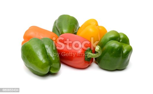 Fresh colorful bell peppers on the white background