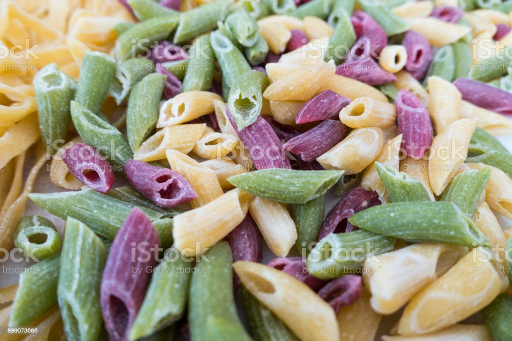 fresh colorful penne pasta stock photo