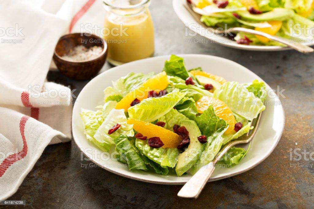 Fresh colorful salad with romaine and orange stock photo