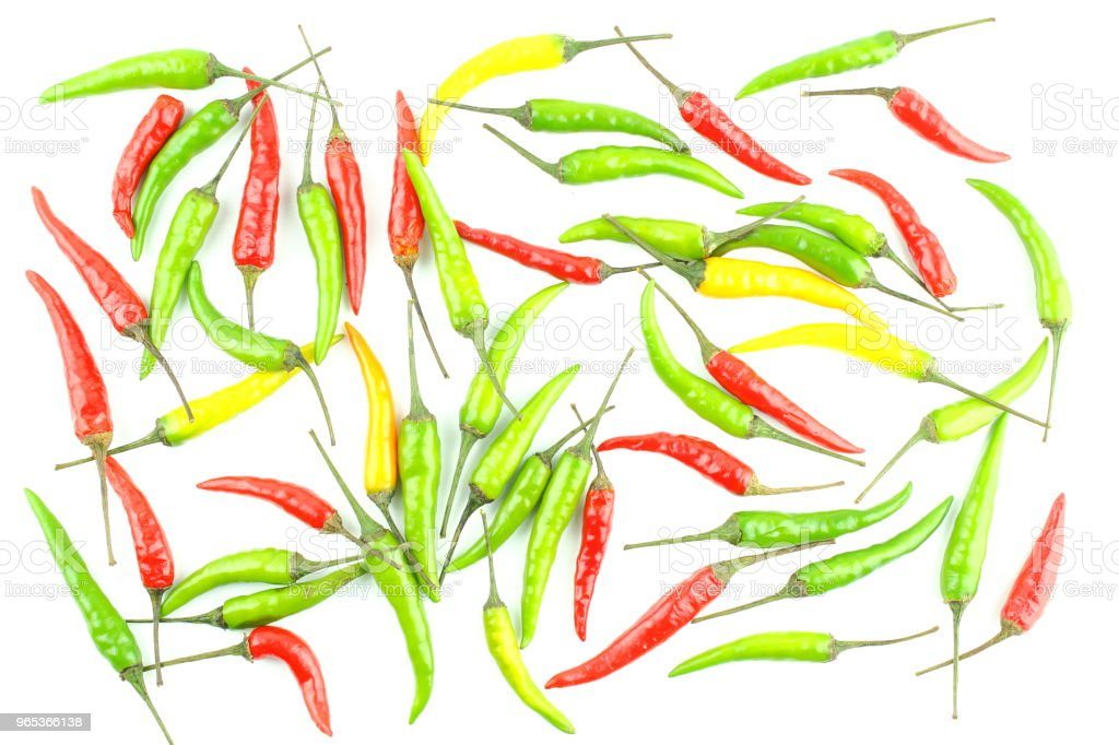 fresh colorful thai chili peppers isolated on a white background food background texture royalty-free stock photo