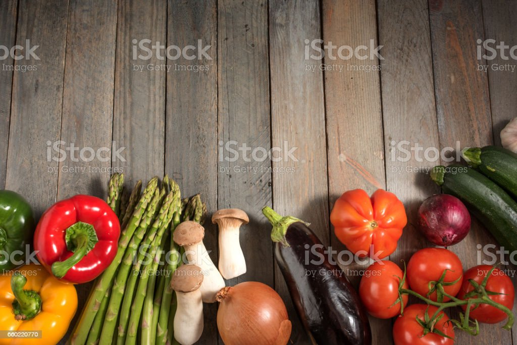 Fresh colorful vegetables on rustic wooden table Fresh asparagus and other vegetables on rustic wooden table for a healthy nutritional concept Asparagus Stock Photo