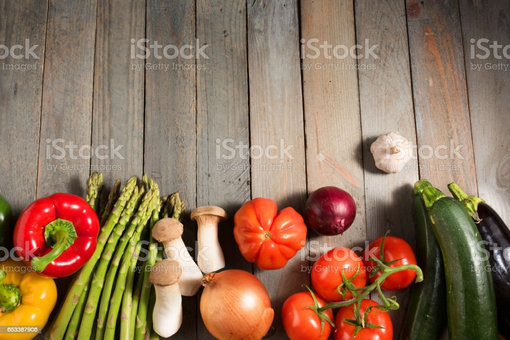 Fresh colorful vegetables on shabby wood stock photo