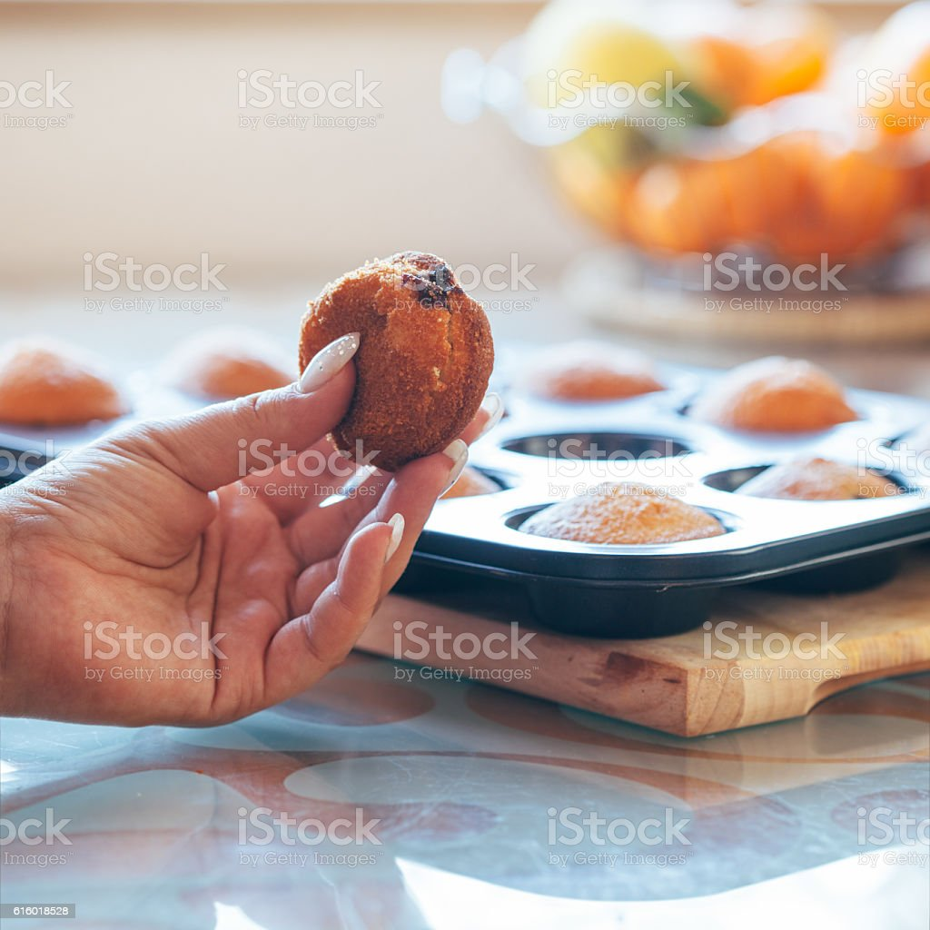 Fresh cookie in hand stock photo