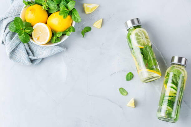Fresh cool lemon cucumber mint infused water detox drink stock photo