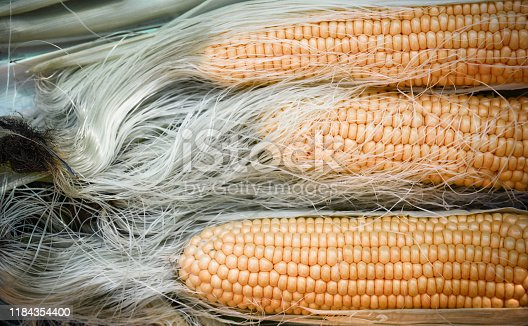 Fresh corn ears On Wooden Table